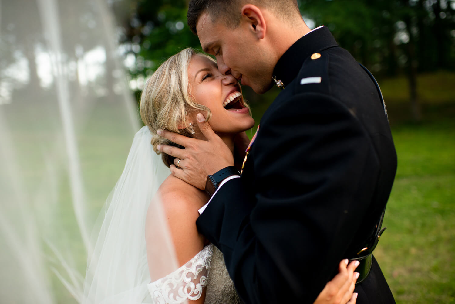 US Marine Groom and Bride laughing outside. Memphis military wedding. Memphis wedding photographer.