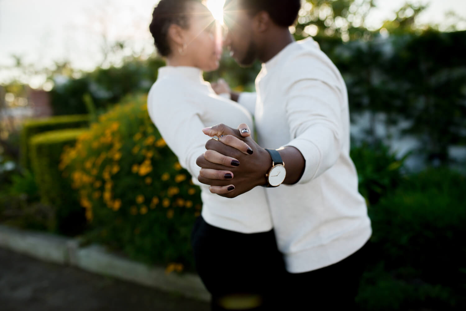 Outside engagement session. Fiances hugging outside with ring showing. Engagement photo fiance holding hands with ring on. Fiances laughing in the street engagement shoot. Fiances looking into each others eyes. smiling at sunset.