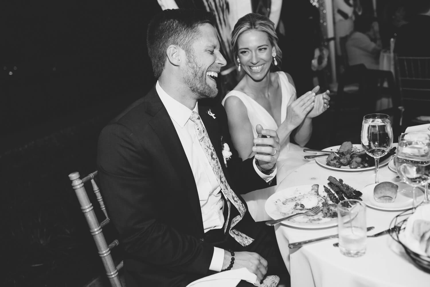 bride and groom laughing at reception by ALN Images.
